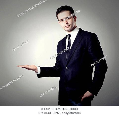 young businessman presenting something on his hand