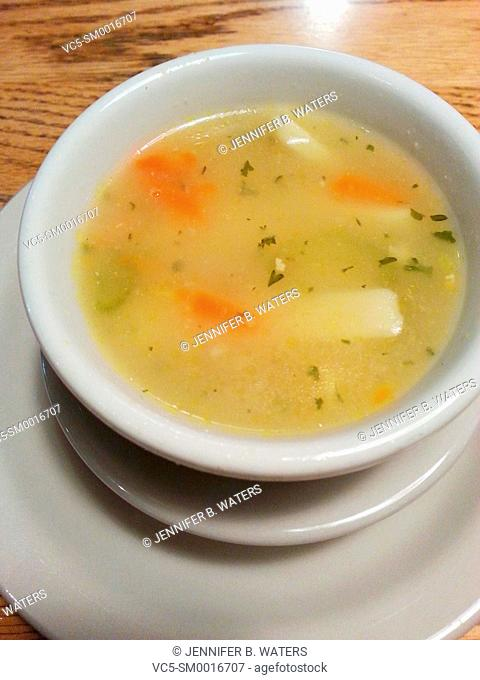 Chicken soup in a white bowl