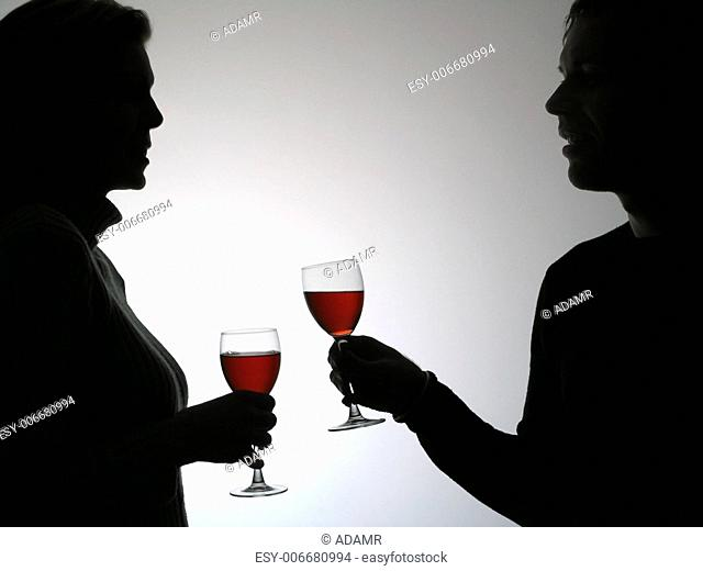 Couple drinking red vine