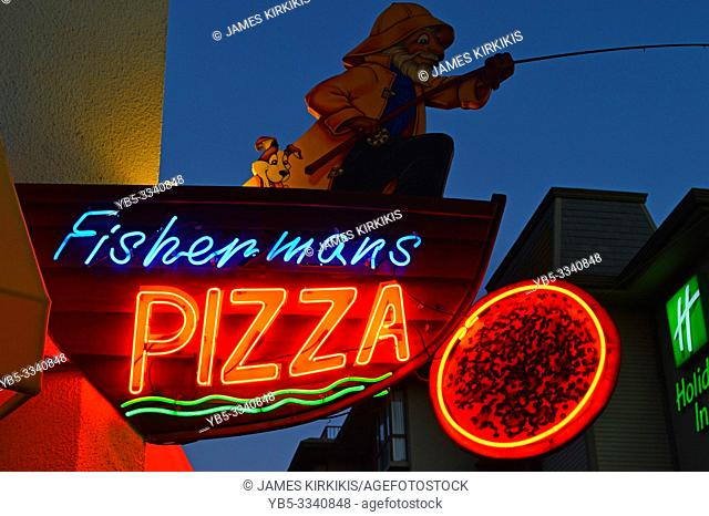 A pizza shop near Fishermanâ. . s Wharf in San Francisco utilizes a nautical theme for their sign