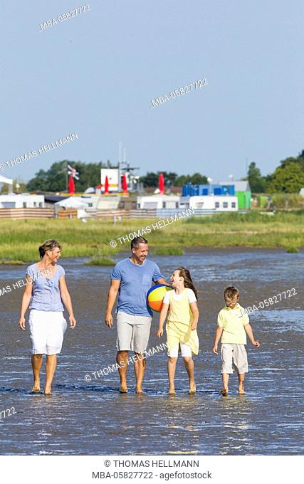 Family in the mud flats