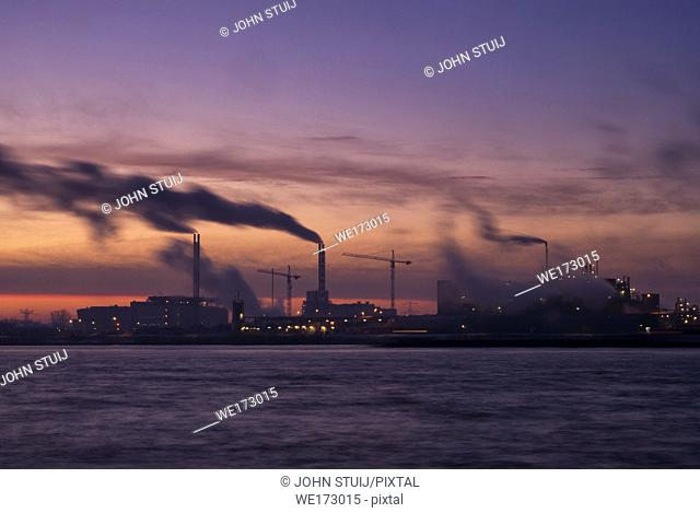 Sunrise above a chemical plant in the Dutch Dordrecht on the banks of the river Beneden-Merwede