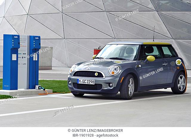 Charging up an electric car at a charging station, Munich, Bavaria, Germany, Europe
