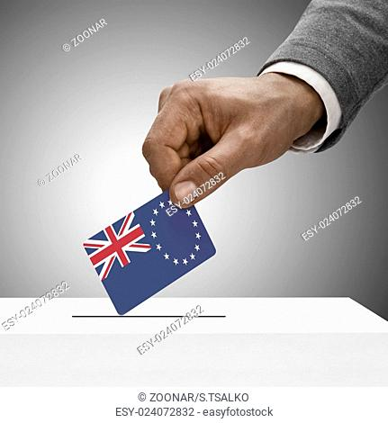 Black male holding flag. Voting concept - Cook Islands