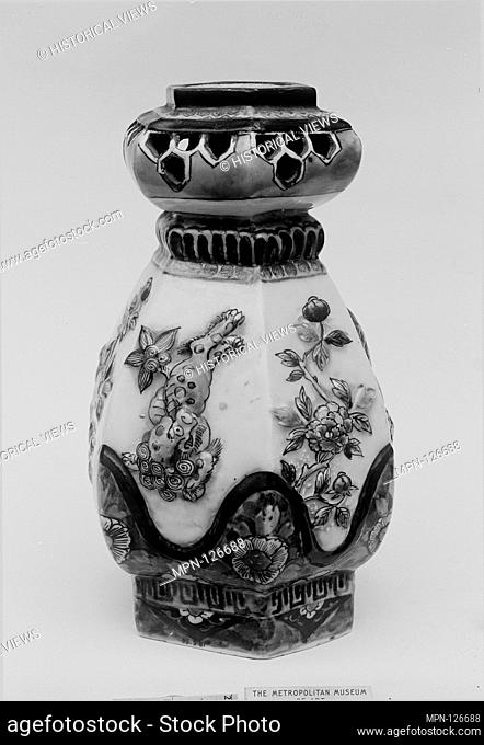 Vase. Date: ca. 1660; Culture: Japan; Medium: White porcelain with slip relief; decorated with blue under the glaze, polychrome enamels (Arita ware);...