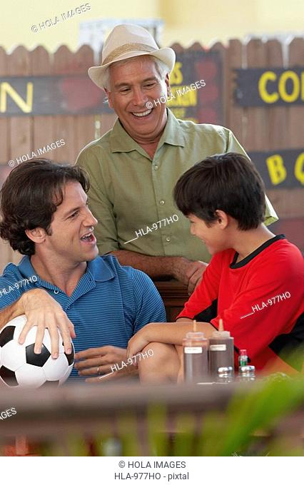Mid adult man with his father and his son in a restaurant