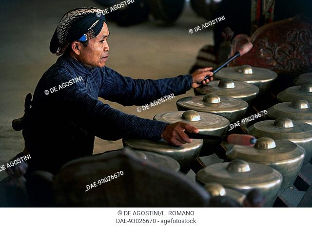 Musician in the gamelan orchestra, Wayang Kulit (shadow puppetry), Java, Indonesia