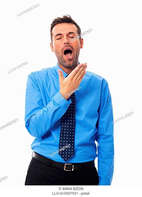 Portrait of yawning handsome business man Debica, Poland