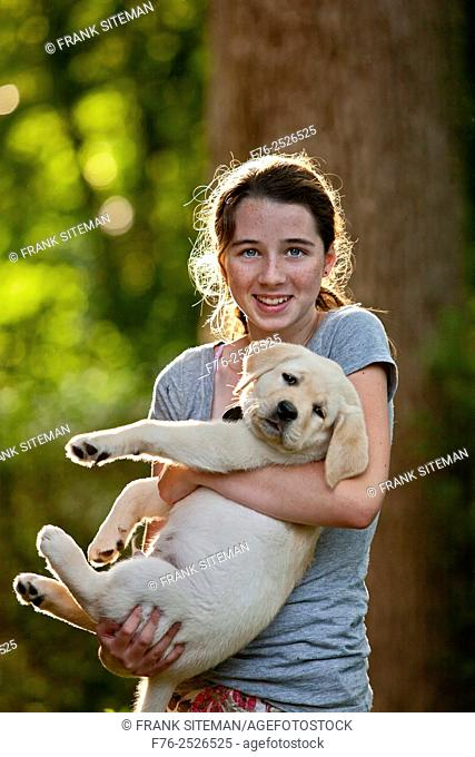 14 year old girl holding 10 week old yellow labrador retriever puppy, MR # 4862