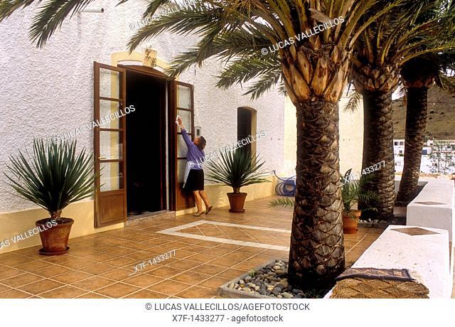 `El Pozo de los Frailes'  Woman working  Cabo de Gata-Nijar Natural Park  Biosphere Reserve, Almeria province, Andalucia, Spain