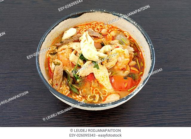 Asian spicy seafood noodle soup, Thai style instant seafood noodle soup, in ceramic bowl