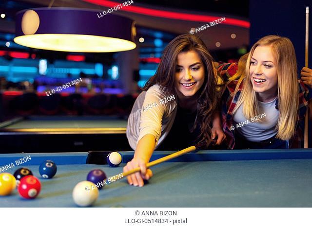 Two female friends enjoying pool game. Rzeszow, Poland