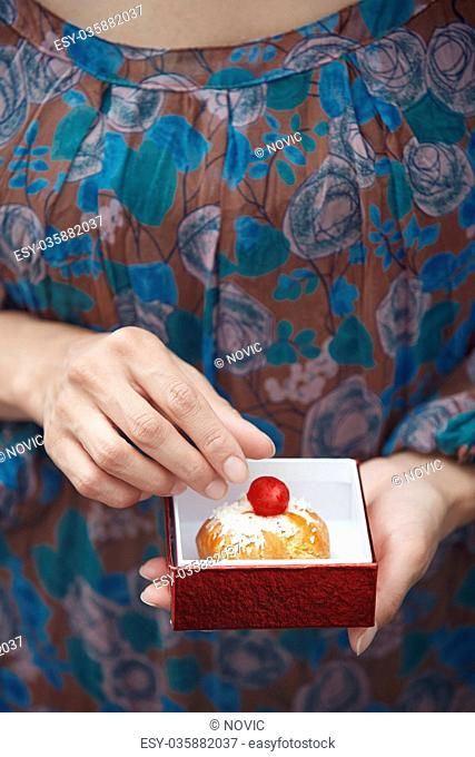 Woman holding Christmas eclair