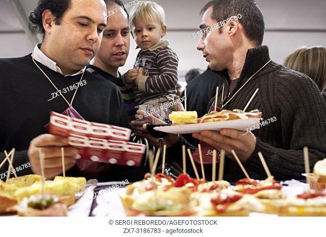 Pintxos degustation in an basque bar in Vitoria Gasteiz during the Ardoaraba festival