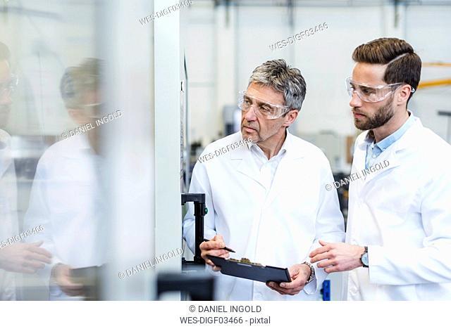 Engineers checking a machine