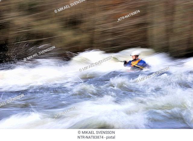 Kayak on rapid, Sweden