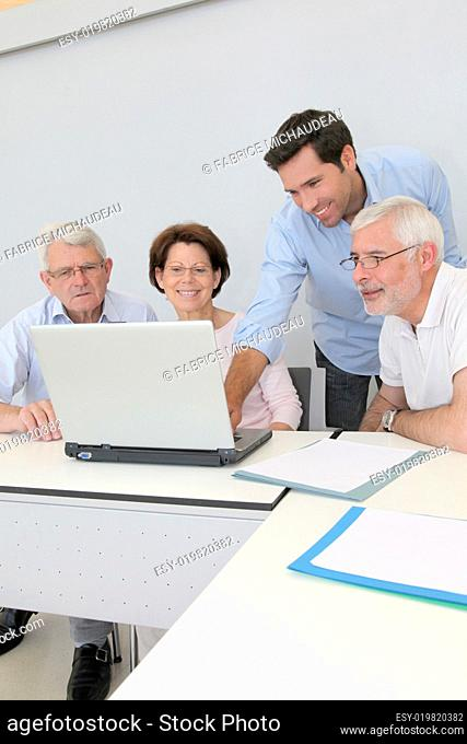 Group of senior people attending job search meeting