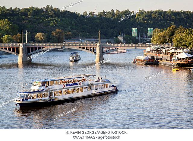 Boat on Vltava River and Manes Bridge, Prague, Czech Republic