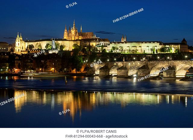 View of Charles Bridge (Karluv Most), Prague Castle and St. Vitus Cathedral at night, Vltava River, Prague, Czech Republic, May