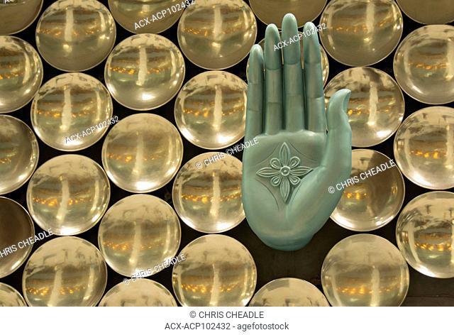 Mudra, hand statue , a symbolic hand gesture used in Hindu and Buddhist ceremonies in Delhi Airport, India