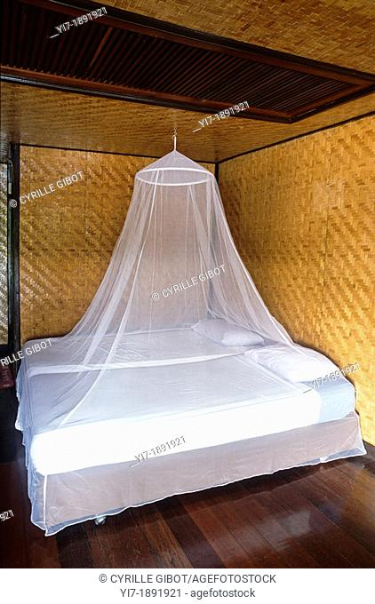 Bed with mosquito net, Thailand