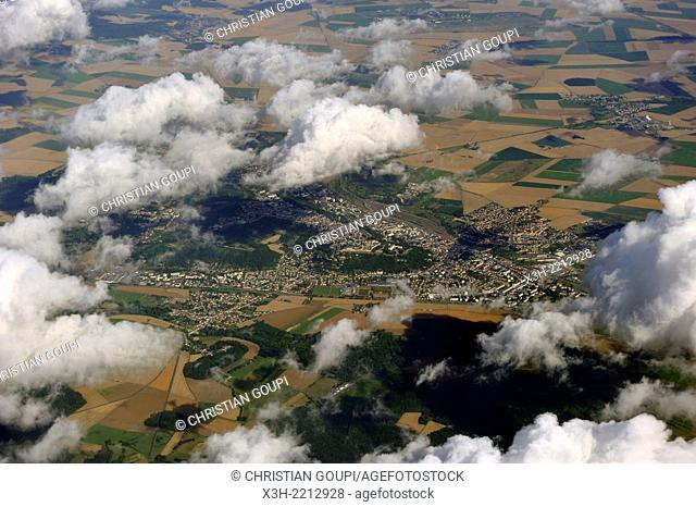 Cumulus clouds floating over fields patchwork, aerial view