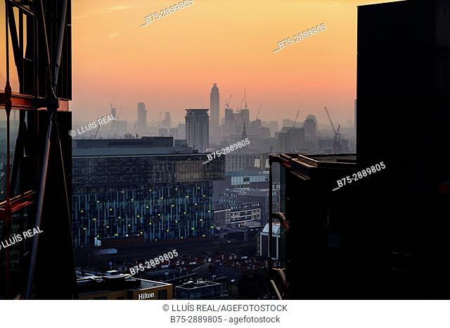 Cityscape with office and residential buildings in the evening. Tate Modern, Bankside, London, England