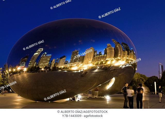 Reflections on the evening of the city of Chicago in the work 'Cloud Gate' by British artist Anish Kapoor Indian origin