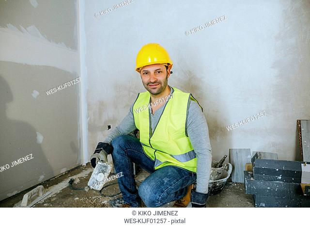 Portrait of construction worker holding a mallet