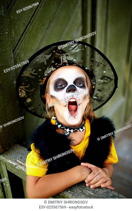 Little girl with open mouth frightening you