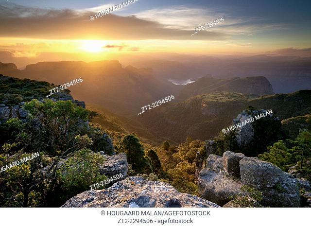 Landscape photo of a dramatic sunset over Blyde River Canyon, viewed from the Mariepskop side. Mpumalanga, South Africa