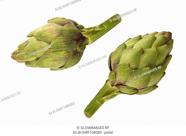 Close-up of two artichokes