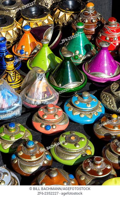 Marrakech Morocco main medina selling pottery to tourists downtown city