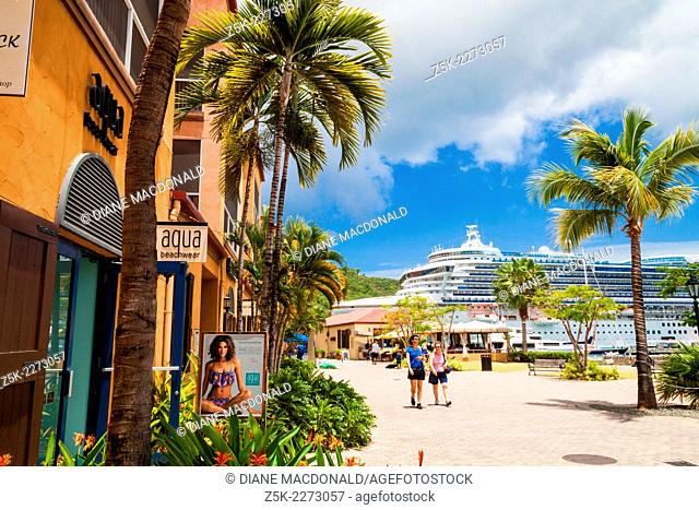 A cruise ship in port at Charlotte Amalie, St. Thomas, US Virgin Islands seen from the dockside shopping center