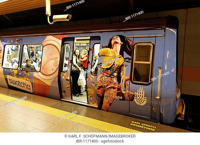 Platform with departing U-Bahn, with Swatch advertising labels, modern subway station, Taksim Square, Beyoglu, Istanbul, Turkey