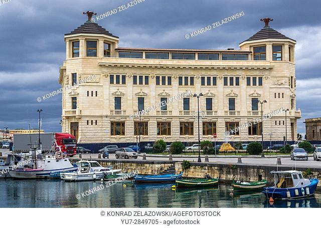 Old Post Office building on the Ortygia island, historical part of Syracuse city, southeast corner of the island of Sicily, Italy