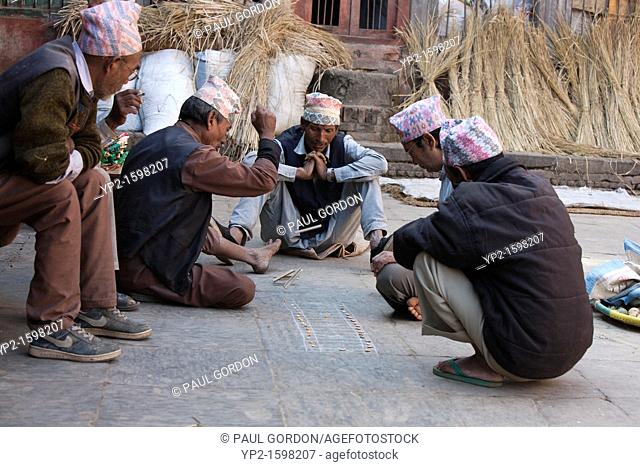 Mature men playing a game in Bhaktapur - Bhaktapur, Kathmandu Valley, Nepal