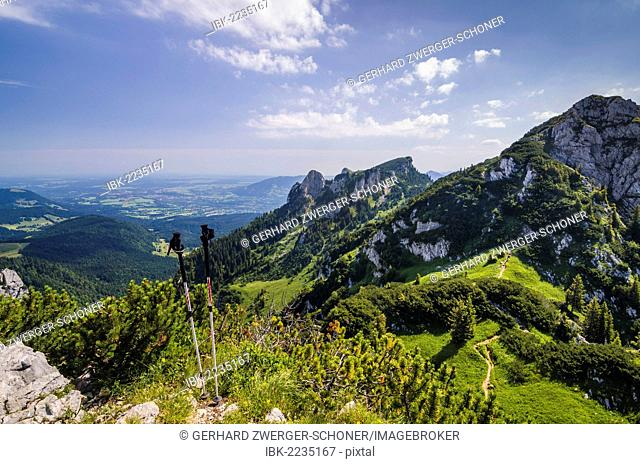 Hiking trail and walking sticks at Benediktenwand mountain ridge, Bavaria, Germany, Europe