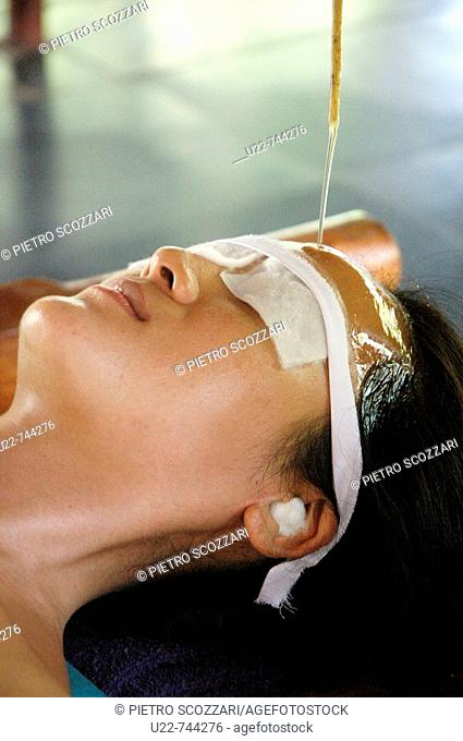 Saligao Goa, India, a woman receiving an ayurvedic massage with oil at the Ayurvedic Natural Health Centre