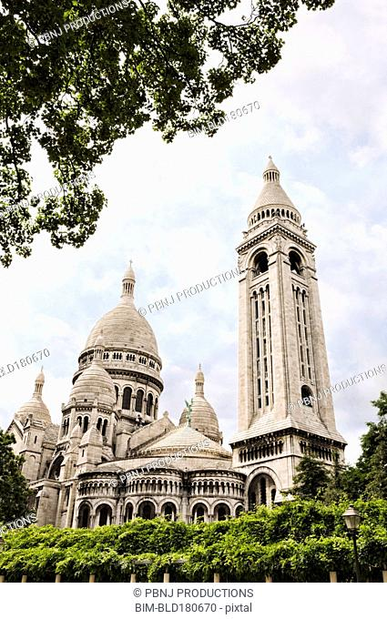 Low angle view of ornate church and dome, Paris, Ile-de-France, France