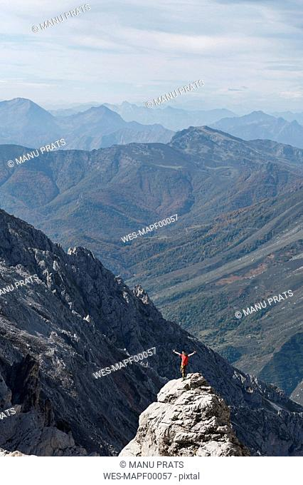 Spain, Picos de Europa, man standing on mountaintop
