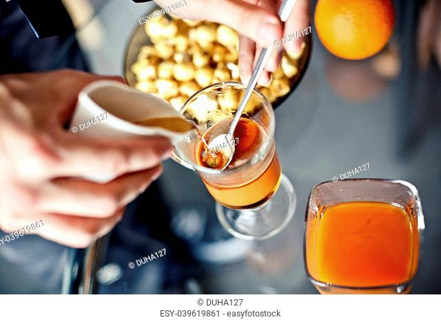 Preparation of coffee with caramel syrup, cream and cinnamon