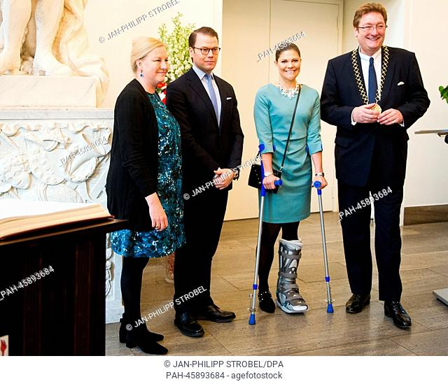 Sweden's Crown Princess Victoria (2-R), injured during a skiing accident, Prince Daniel (2-L), Swedish Minister for Foreign Trade Ewa Bjornling (L) and Lord...