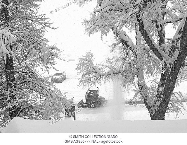 Sidewalk plow shoveling snow at Mammoth Hot Springs in Yellowstone National Park, November 4, 2015. Image courtesy of Yellowstone National Park