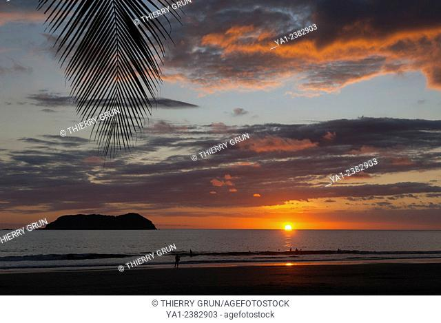 Costa Rica. Pacific coast, Puntarenas province, Manuel Antonio, Playa Espadilla beach at sunset, back islas Gemelas, Latin America