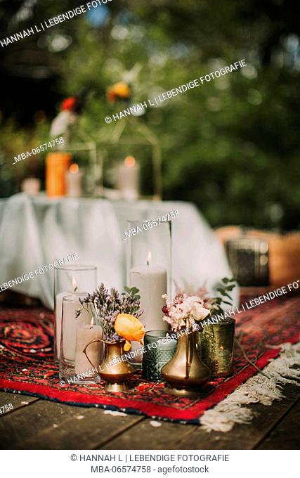 Festive laid table at alternative wedding celebration outside, detail