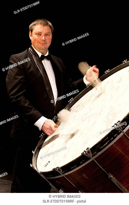 Bass drum player in orchestra