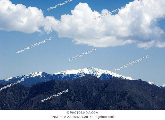 Clouds over a snowcapped mountain, Sanasar, Jammu And Kashmir, India