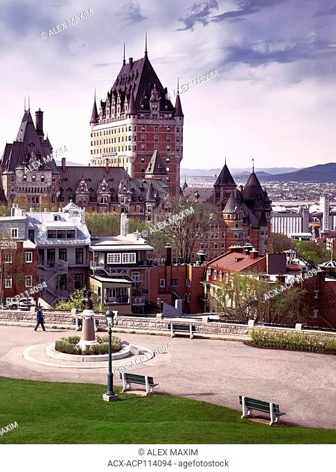 Scenic view of Fairmont Le Château Frontenac with dramatic sky, luxury grand hotel Chateau Frontenac, National Historic Site of Canada