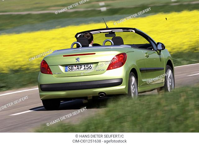 Peugeot 207 CC 120 Sport, model year 2007-, green, driving, diagonal from the back, rear view, country road, open top